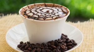 Coffee Lattee Art In White Cup Wallpaper Free Photo