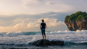 Man Standing On Rock Looking Water Wave HD Image Free Wallpaper